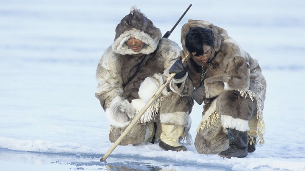 Inuit men hunting in traditional dress, Nunavut, Canada - © Rémy Marion