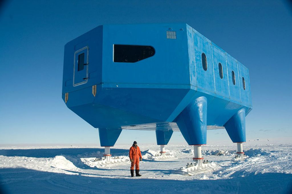 Halley VI Project Manager Karl Tuplin stands besides the completed module. - © British Antarctic Survey