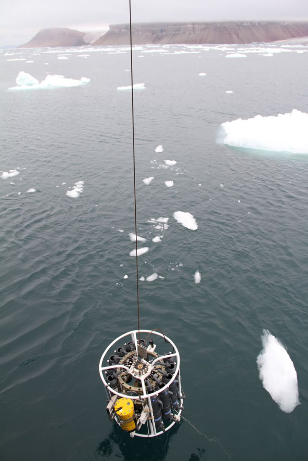 Taking samples from the water - © Agneta Fransson, Norwegian Polar Institute