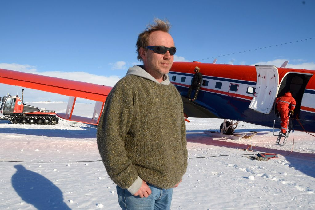Christian Müller poses in front of AWI's Polar 6 aircraft after flying a mission. - © International Polar Foundation / Jos Van Hemelrijck