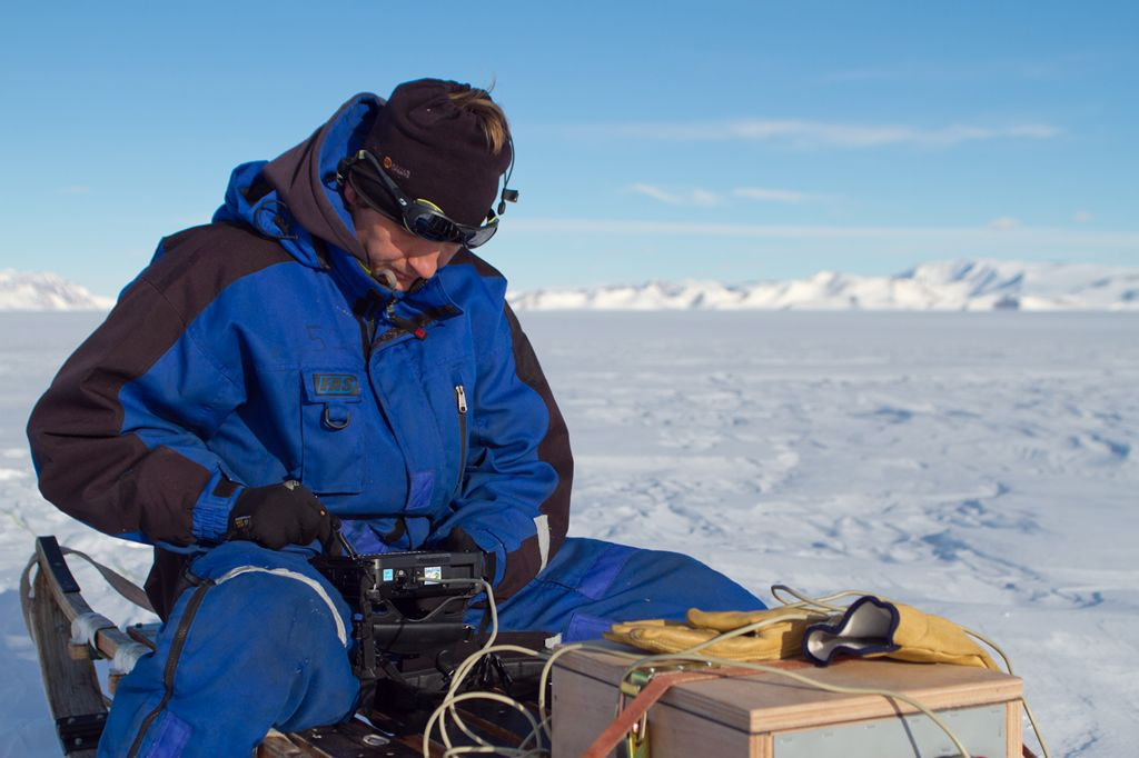 2012 laureate Reinhard Drews working with a radar device he used to image the Roi Baudoin Ice Shelf. - © Lionel Favier