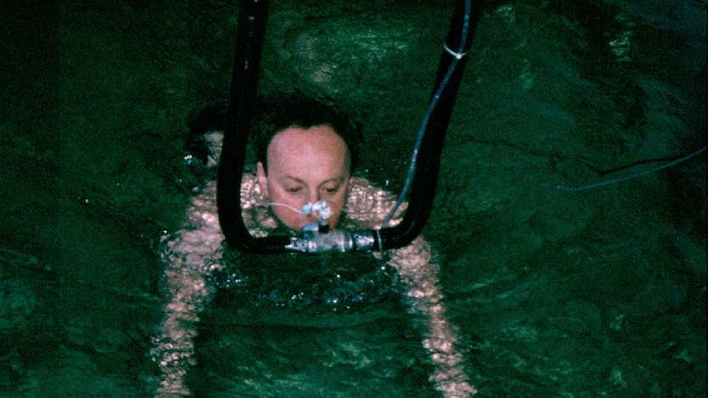 Professor Tipton takes part in one of his own experiments to see how the body reacts as it is exposed to cold water. Here, he takes a 90 minute swim in water at 10°C. - © Michael Tipton