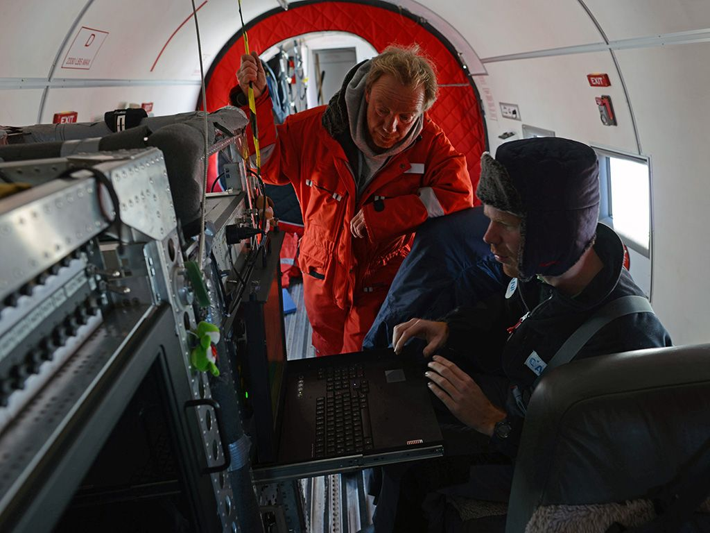 Christian Müller and Tobais Binder checking instruments prior to takeoff. - © International Polar Foundation / Jos Van Hemelrijck