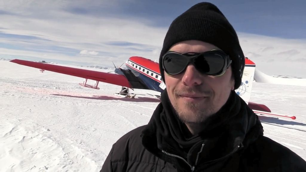 Graeme Eagles, AWI geophysicist, poses in front of AWI's Polar 6 aircraft - © International Polar Foundation / Jos Van Hemelrijck