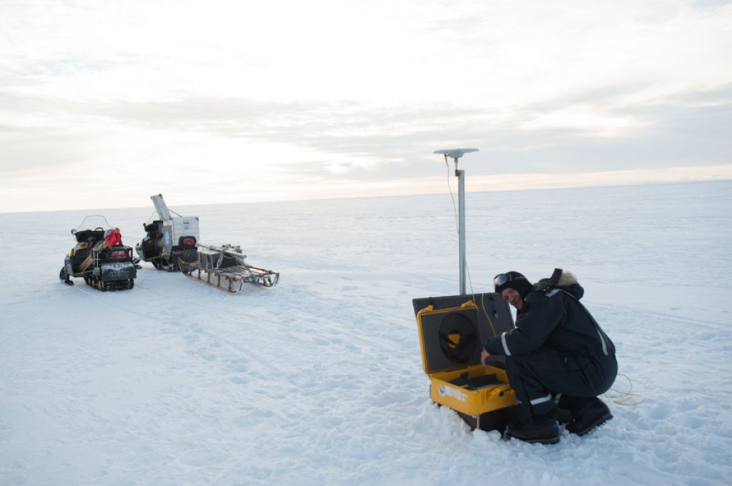 Glaciologist and InBev-Baillet Latour Antarctic Fellowship recipient Reinhard Drews installing a GPS station on the King Baudoin ice shelf as part of the Be:Wise scientific project. - © International Polar Foundation