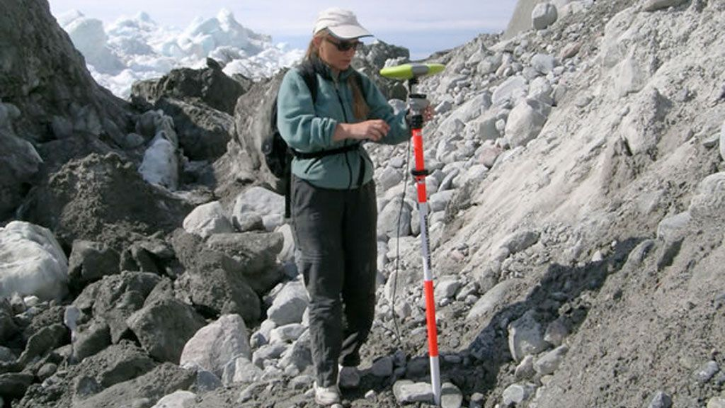 Dr.  Beáta Csathó setting up instruments in Greenland